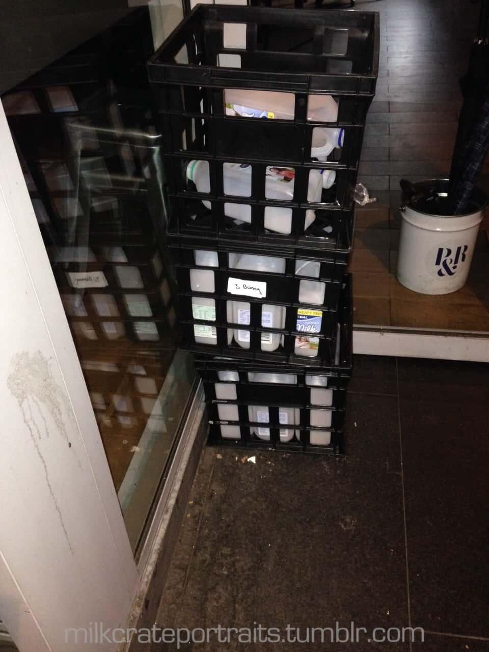 Milk crates with empty milk bottles in them.