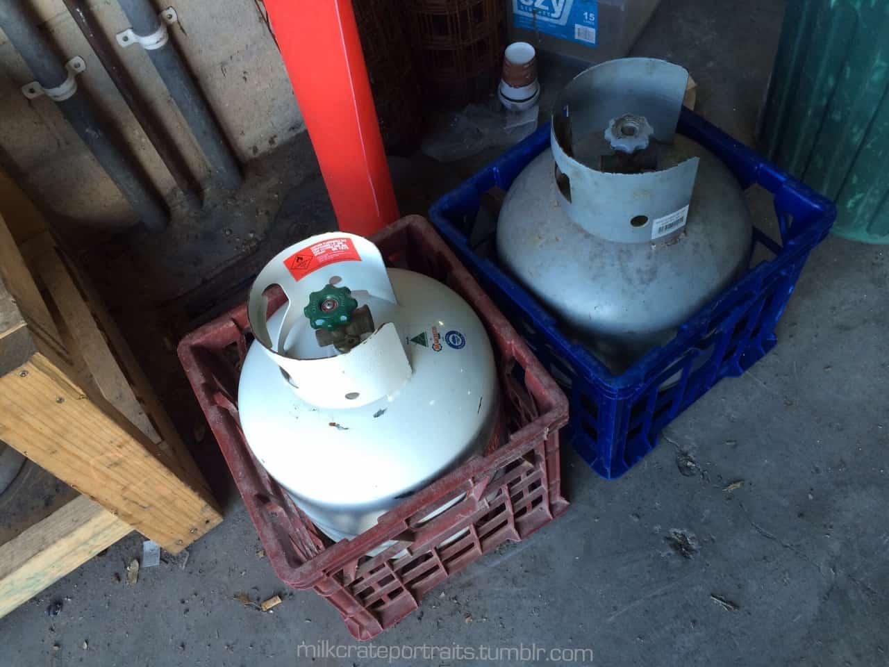 Gas bottles in milk crates
