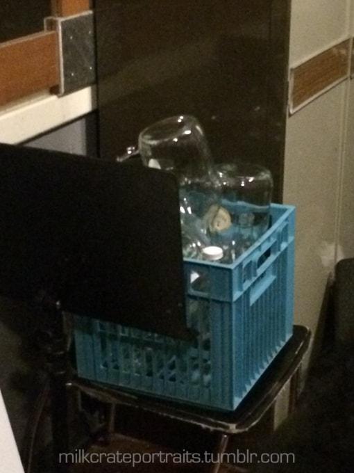 Empty bottle in milk crate