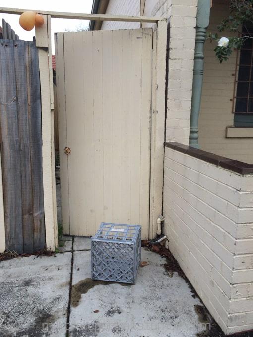 Grey crate in the doorway